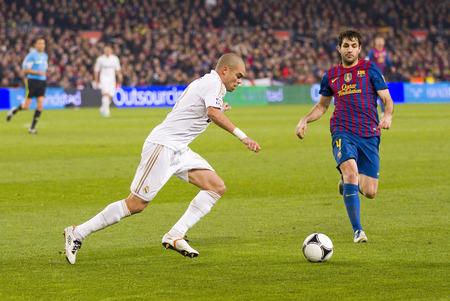 to pepe: Pepe Laveran in action at the Spanish Cup match between FC Barcelona and Real Madrid, final score 2 - 2, on January 25, 2012, in Camp Nou, Barcelona, Spain