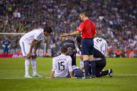 Doctors with injured player at the Spanish Cup match between UE Cornella and Real Madrid, final score 1 - 4, on October 29, 2014, in Cornella, Barcelona, Spain