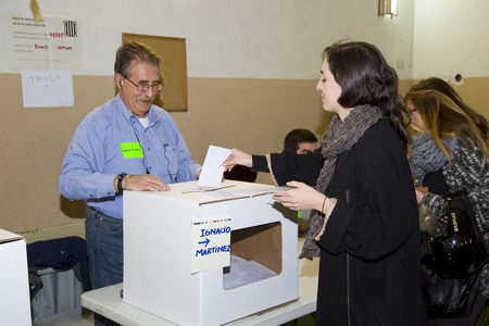 central government: Unidentified woman votes in symbolic referendum on Catalonia independence, in defiance of the central government in Madrid, on November 9, 2014, in El Masnou, Barcelona, Spain Editorial