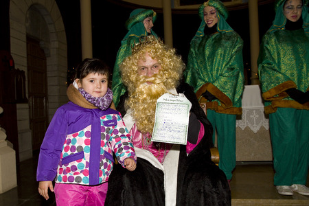 caspar: Caspar King and little girl at the Biblical Magi Three Wise Men parade, who give toys to the children. Is a traditional spanish celebration. January 5, 2014 in Barcelona, Spain