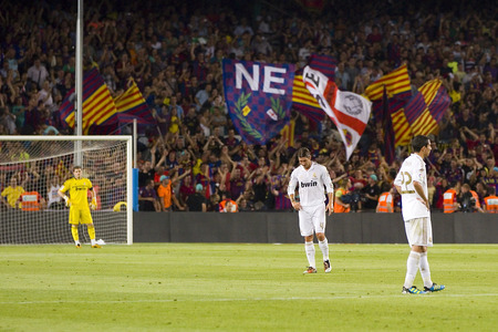real madrid: Some supporters celebrating a goal at the Spanish Super Cup final match between FC Barcelona and Real Madrid, 3 - 2, on August 17, 2011 in Camp Nou stadium, Barcelona, Spain