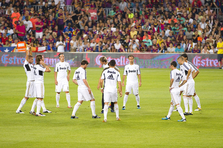 Real Madrid players in action at the Spanish Super Cup final match between FC Barcelona and Real Madrid, 3 - 2, on August 17, 2011 in Camp Nou stadium, Barcelona, Spain