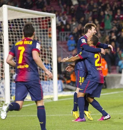 leo messi: Leo Messi and other players celebrating a goal at the Spanish League match between FC Barcelona and Osasuna, final score 5 - 1, on January 27, 2013, in Barcelona, Spain