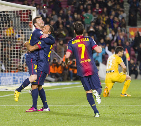 messi: Leo Messi and other players celebrating a goal at the Spanish League match between FC Barcelona and Osasuna, final score 5 - 1, on January 27, 2013, in Barcelona, Spain