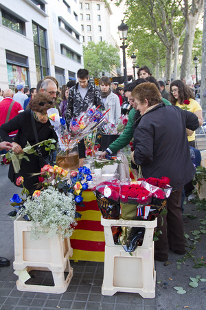 famous women: Diada de Sant Jordi or Saint George Day, a famous Catalan celebration, on April 23, 2013, in Barcelona, Spain. Traditionally, men gave women roses, and women gave men a book