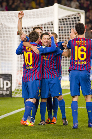 xavi: FCB players celebrating a goal at the Spanish Cup match between FC Barcelona and Osasuna final score 4  0 on January 4 2012 in Camp Nou stadium Barcelona Spain