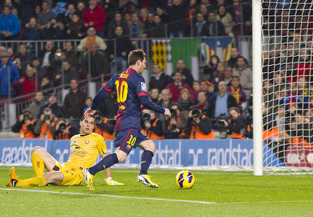 messi: Lionel Messi scores a goal at the Spanish League match between FC Barcelona and Osasuna final score 5  1 on January 27 2013 in Barcelona Spain