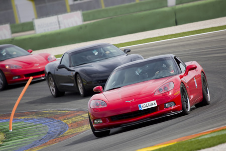 corvette: A red Chevrolet Corvette C6 take part in American Fest weekend organizated in circuit Ricardo Tormo, on April 25, 2015, in Cheste, Valencia, Spain