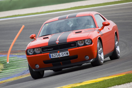 rt: A red Dodge Challenger RT take part in American Fest weekend organizated in circuit Ricardo Tormo, on April 25, 2015, in Cheste, Valencia, Spain Editorial
