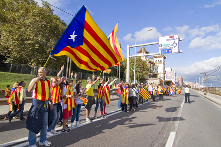 nationalists: Catalans made a 400 km human chain to show their desire for independence from Spain, on Sept. 11, 2013 in Barcelona, Spain. More than 1 million people took part in the event Editorial