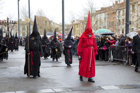People at Procession de la Sanch, an annual ceremony in several towns of Southern Europe during Easter Holy Week, on March 25, 2016, in Perpignan, France