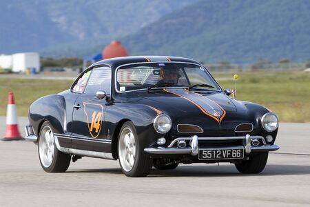 A Volkswagen Karmann Ghia take part in Road and Track racing weekend organized by American Car Club, on October 7, 2012, in La Seu d'Urgell, Spain.