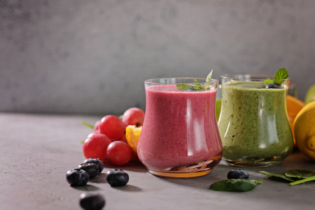Colorful smoothie, healthy detox vitamin diet. Vegan drinks with fresh fruits