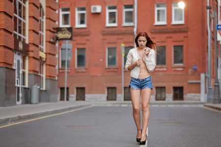 Hot sexy redhair woman in the city. Half naked girl. Fashion art photo. Banque d'images