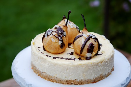 Beautiful pear cheesecake with caramel and chocolate drop Stok Fotoğraf - 122757643
