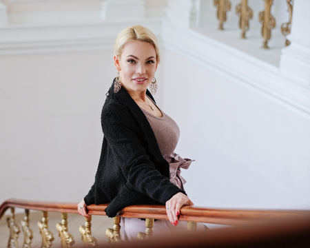 Portrait of a beautiful woman with blond hair, indoors