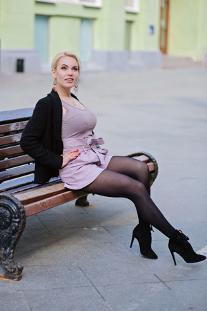 Portrait of a beautiful woman with blond hair, outdoors