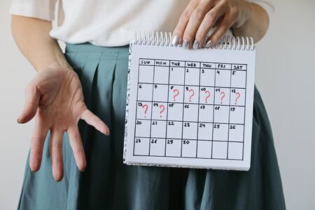 Missed period and marking on calendar. Unwanted pregnancy, womans health and delay in menstruation.