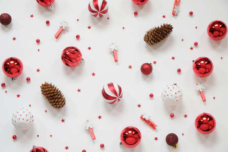 Christmas composition - red decorations on white background. Christmas, new year concept. Flat lay, top view