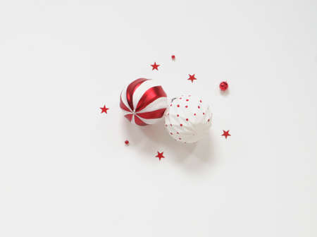 Christmas composition - red decorations on white background, minimalism