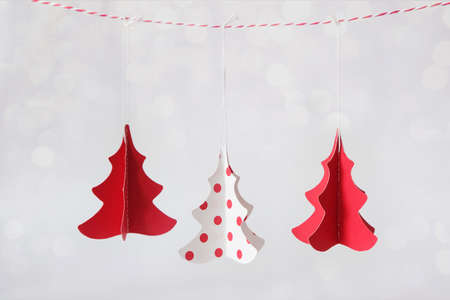 Three Christmas trees made from paper in red and white