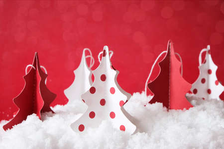 christmas tree made from paper in white and red, on snow, decoration