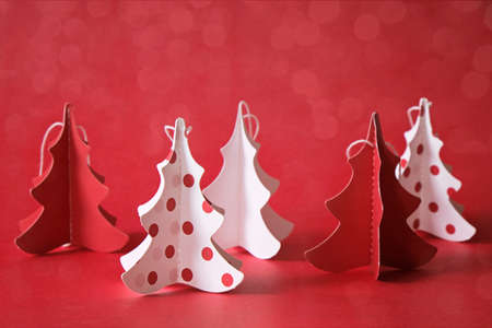 Christmas tree made from paper in white and red, decoration