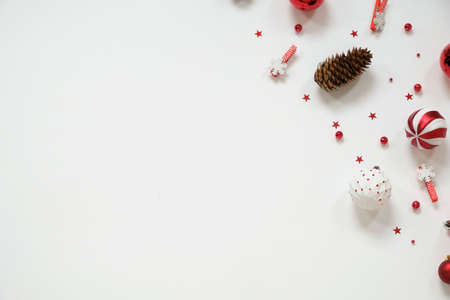 Christmas composition - red decorations on white background with copy space Imagens - 156171241