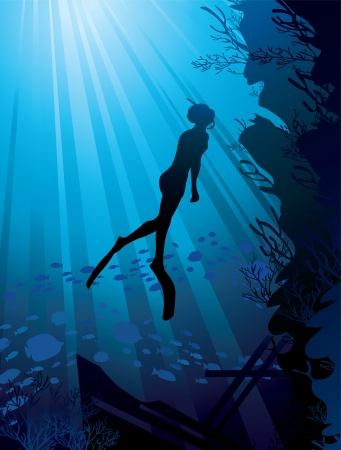 freediver: Silhouette of freediver and marine reef on a sun ray in sea