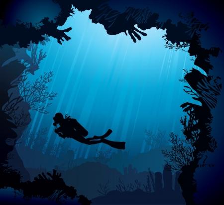 cueva: Arrecife de coral con la silueta de buzo en el fondo del mar azul