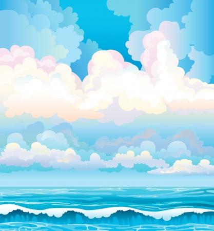 Groep van wolken op een blauwe hemel en turquoise zee met golven
