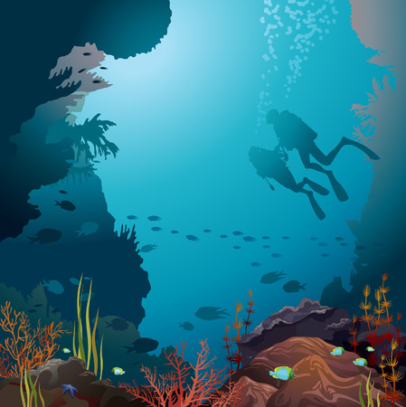 Two scuba divers and coral reef with underwater creatures.