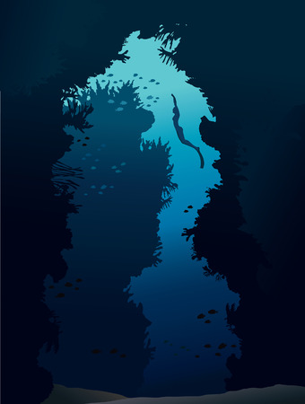 free diver: Underwater cave with coral reef and silhouette of free diver on a blue sea.
