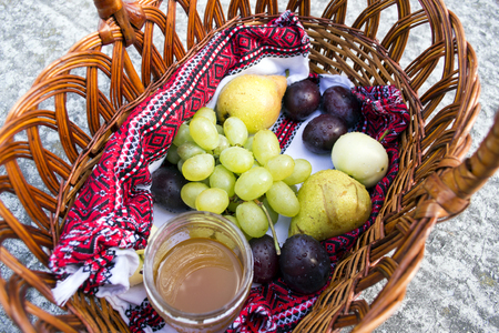 consecrated: Basket with sanctified apples, plums, pears and grapes on the feast of the Transfiguration