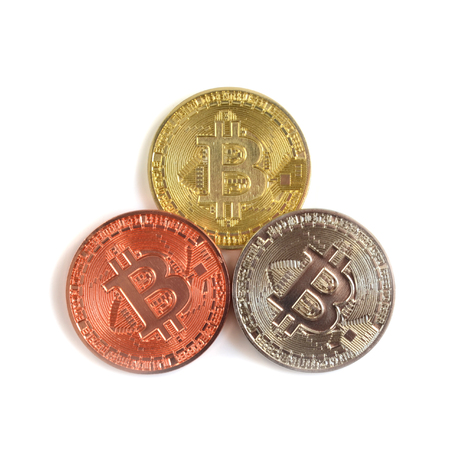 Bitcoin coins of different colors on white background
