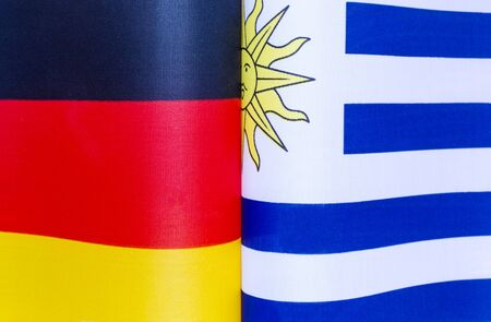 national flags of Germany and Uruguay close-up policy 写真素材