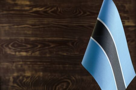 Fragment of the flag of the Republic of Botswana in the foreground space for text blurred background Archivio Fotografico