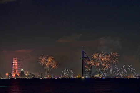New year celebration with fireworks in Burj Al Arab and Burj Khalifa photo