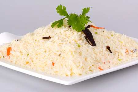 ghee: Indian Ghee rice on white plate Stock Photo