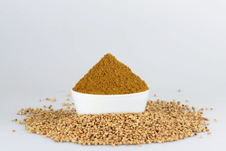 Coriander seed in white bowl on the white background photo