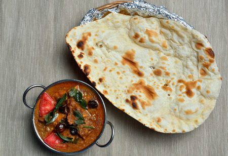 chicken curry: Chettinad Chicken curry with Naan bread Stock Photo