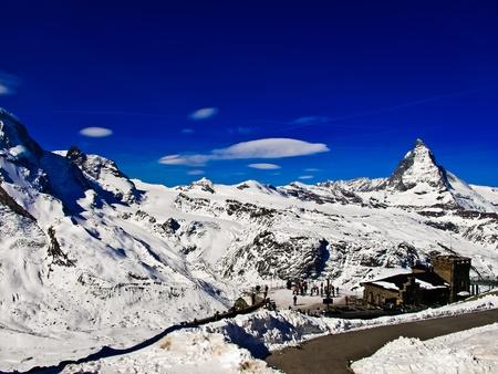 chocolate peak: Landscape of Gornergrat Train Station and Matterhorn peak, logo of Toblerone chocolate, located at Switzerland