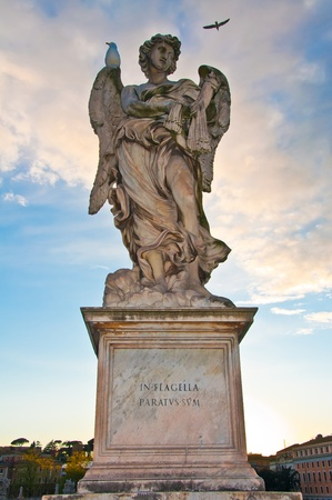 Berninis marble statue of angel from the SantAngelo Bridge in Rome, Italy  photo