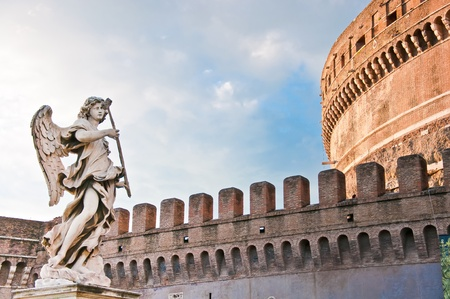 rome italy: Berninis marble statue of angel from the SantAngelo Bridge in Rome, Italy