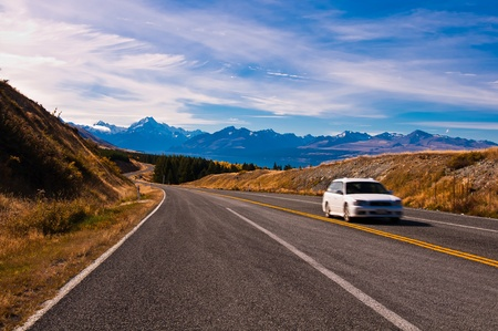 blur white car on Scenic mountain road in the Southern Alps of the South Island of New Zealand  photo