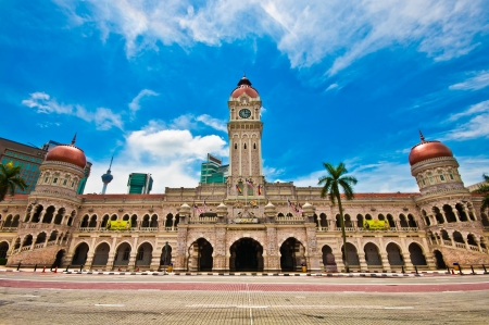 Masonry facade of the historical Sultan Abdul Samad Building in Merdeka Square, Kuala Lumpur, draped a giant Malaysian flag to celebrate Malaysian independence  The building is a tourist attraction