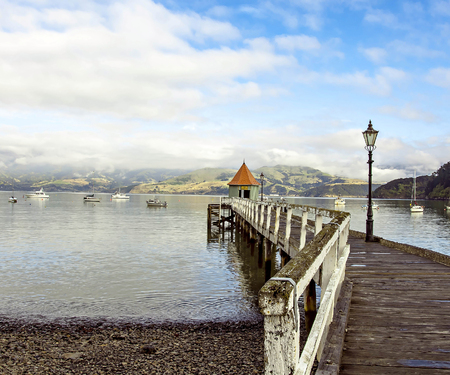 jetty pier building on lake at Akaroa New Zealand photo
