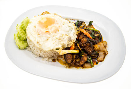 Spicy fried catfish with rice and egg photo