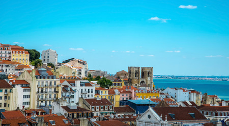 Panorama of old traditional city of Lisbon with red roofs photo