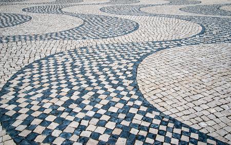 Lisbon typical mosaic, detail of a mosaic in an old typical Lisbon street, urban art photo